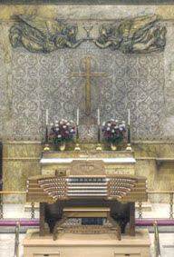 electric organ console in chancel, as shown in concert position